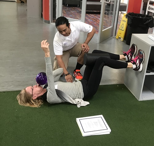 This is an image of me teaching a 90/90 Hip Lift at a course I was helping with in California.